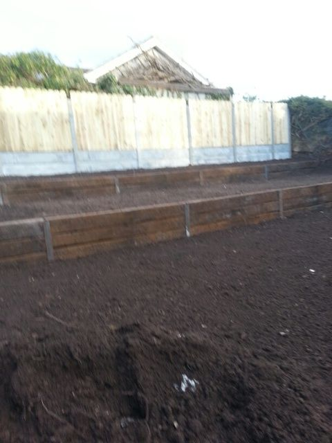 Railway sleeper retaining wall and fencing
